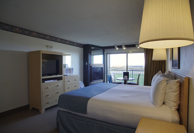 Hi-Tide Oceanfront Inn, Seaside, Camera, 1 letto king, vista parziale, di fronte alla spiaggia, Area soggiorno