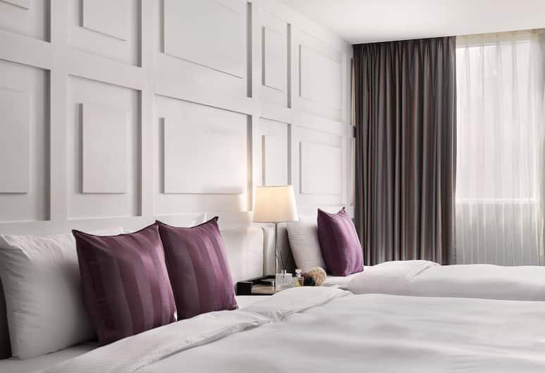 Muzik Hotel - Ximen Station Branch, Tchaj-pej, Trojlôžková izba typu Superior, viacero postelí, bez okien, Hosťovská izba