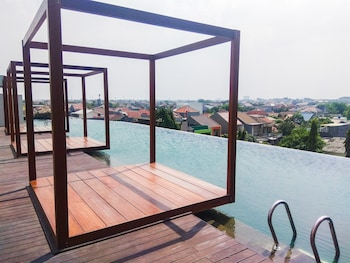 Picture of Simply Furnished with City View @ Studio Grand Kamala Lagoon Apartment in Bekasi