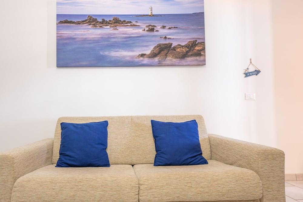 Leilighet, 1 soverom, kjøkken, delvis utsikt mot sjø - Oppholdsområde