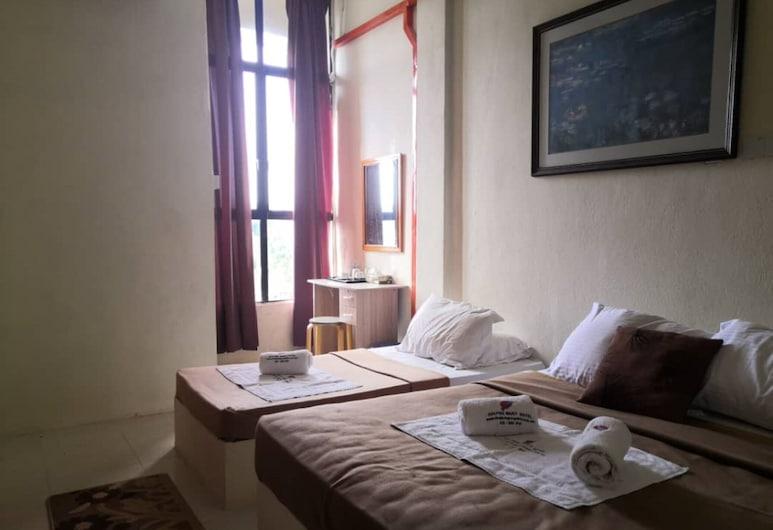 OYO 90131 Zayyan Hotel, Kampung Raja, Třílůžkový pokoj typu Deluxe, Pokoj