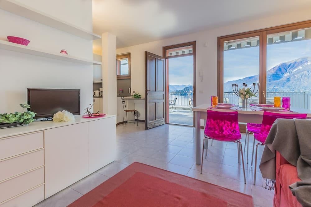 Deluxe appartement, uitzicht op meer - Woonruimte