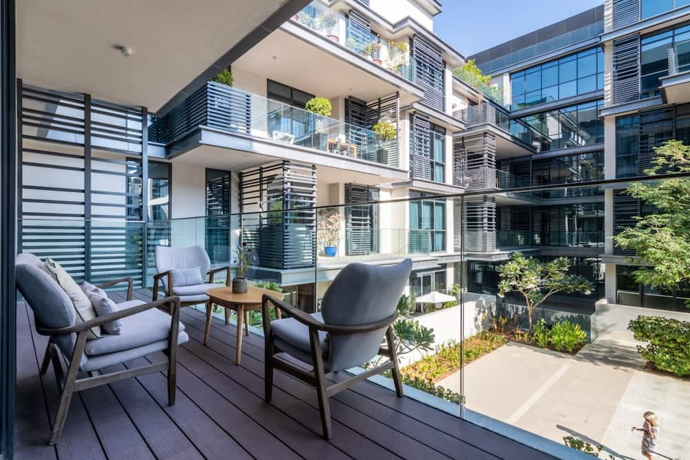 Apartamentai su pagrindiniais patogumais, Kelios lovos - Balkonas