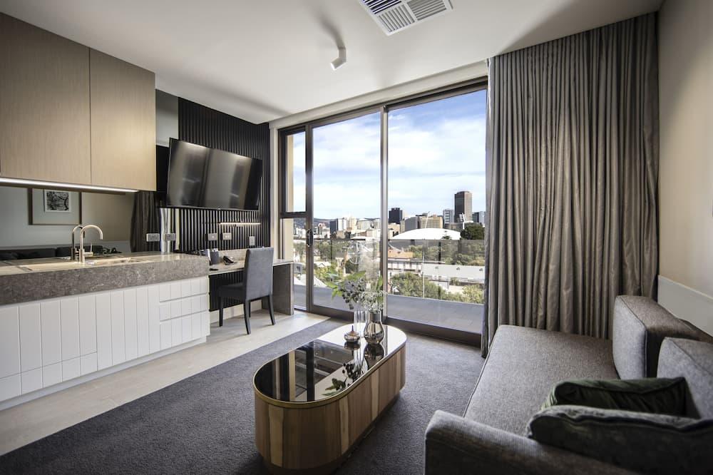Suite, 1 Schlafzimmer, Whirlpool - Wohnbereich