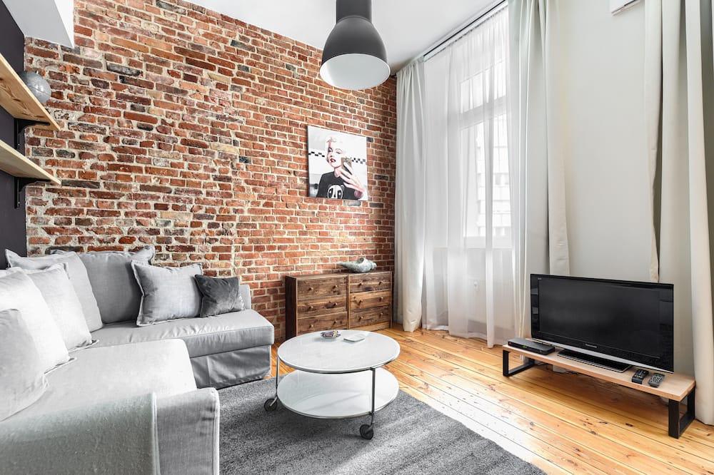 Dzīvokļnumurs ar papildu ērtībām - Dzīvojamā istaba