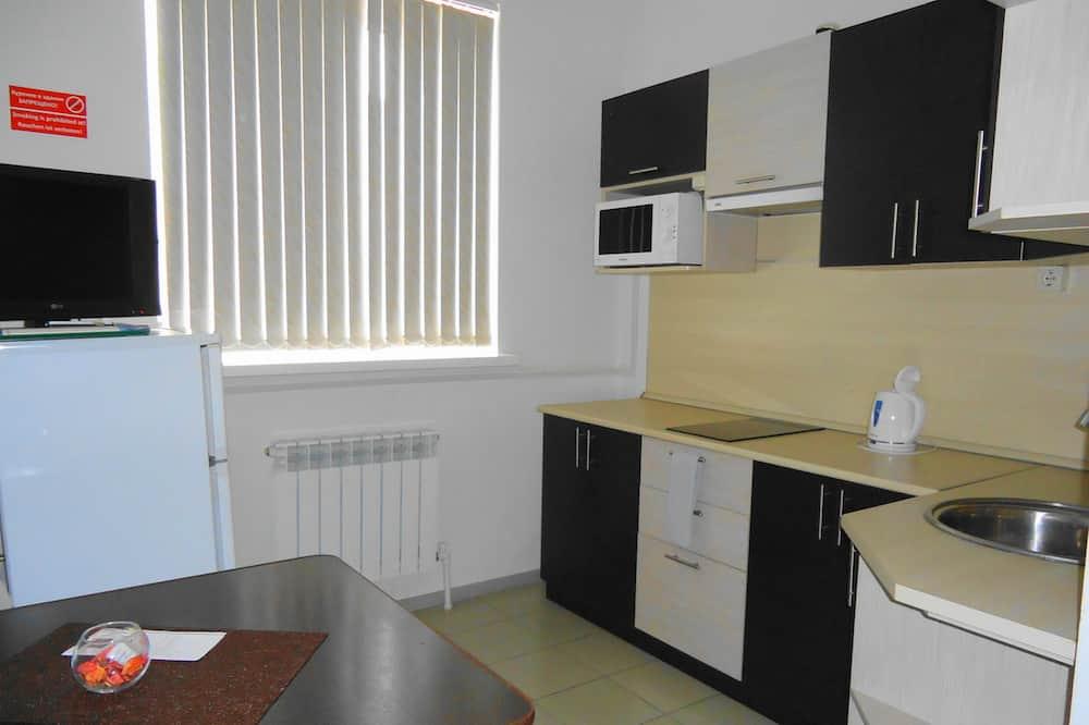 Appartement Affaires - Restauration dans la chambre
