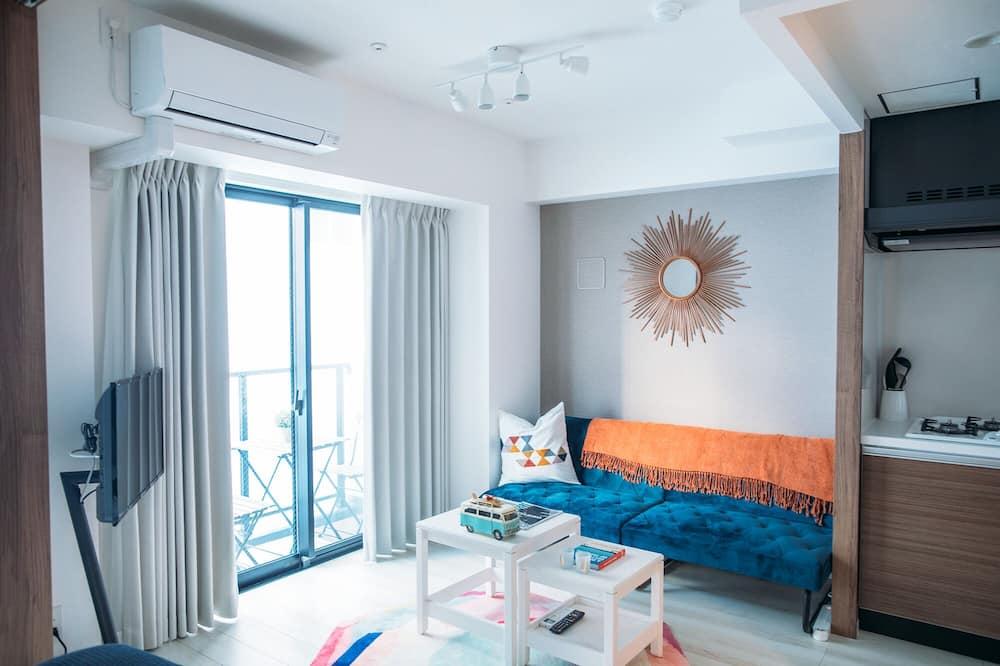 Deluxe Studio Suite - Living Room