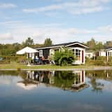 Comfortable Chalets, Situated Round a Pond in a Small-scale Holiday Park