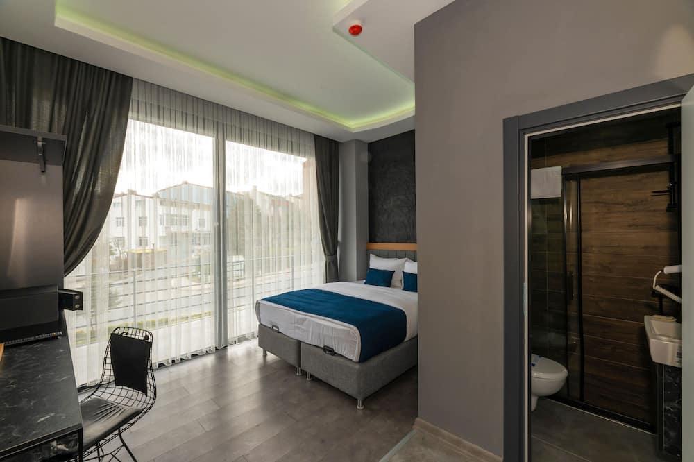 Habitación Deluxe con 1 cama doble o 2 individuales, balcón - Habitación