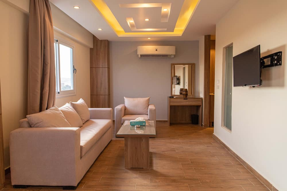 Suite with garden view - Coin séjour