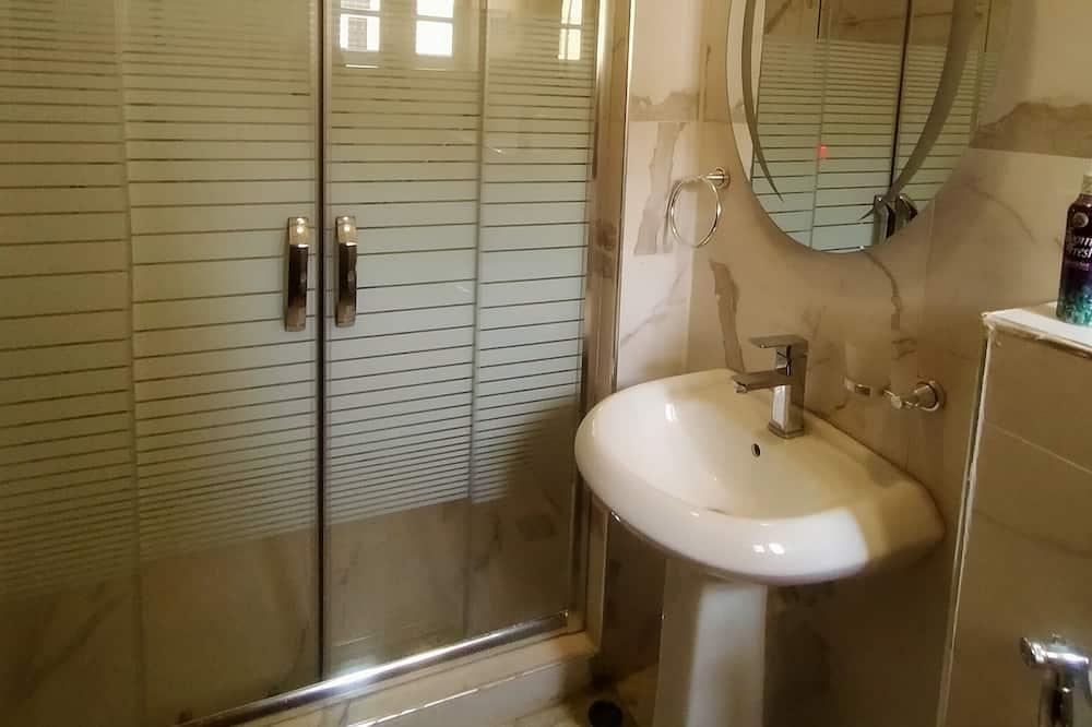 Pokoj typu Deluxe - Koupelna