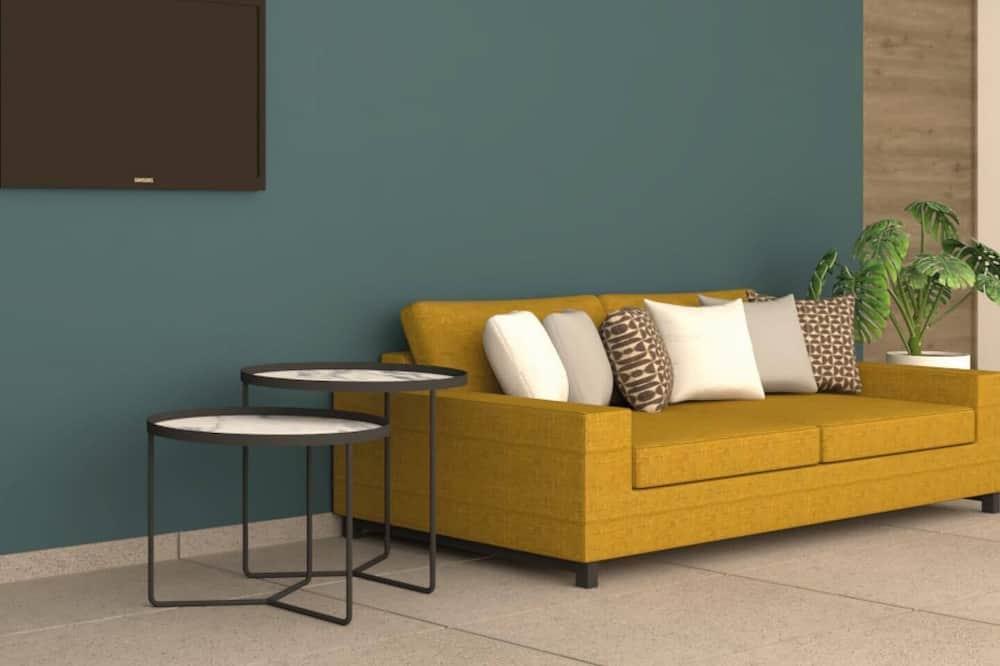 スーペリア スイート キングベッド 1 台ソファーベッド付き - リビング エリア