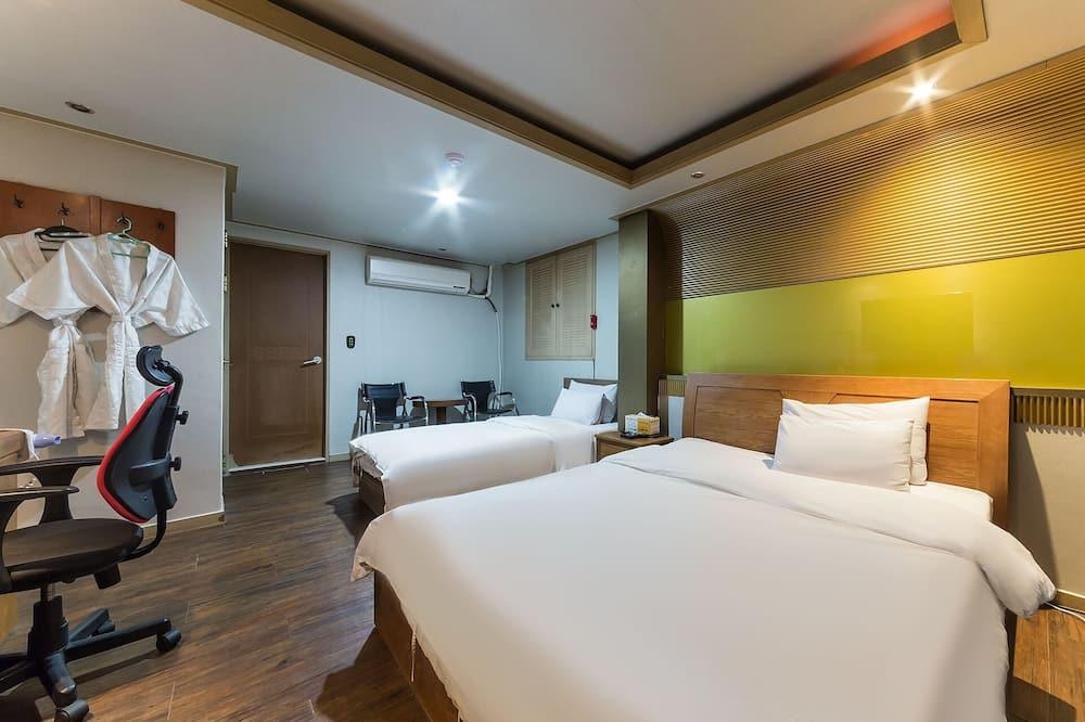 חדר (Twin Bed Room) - עיצוב הבניין
