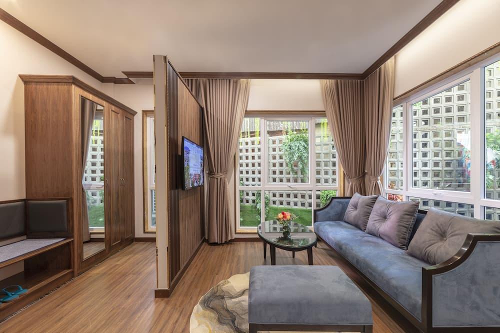 Suite – junior, 1 kingsize-seng, utsikt mot bakgård - Oppholdsområde