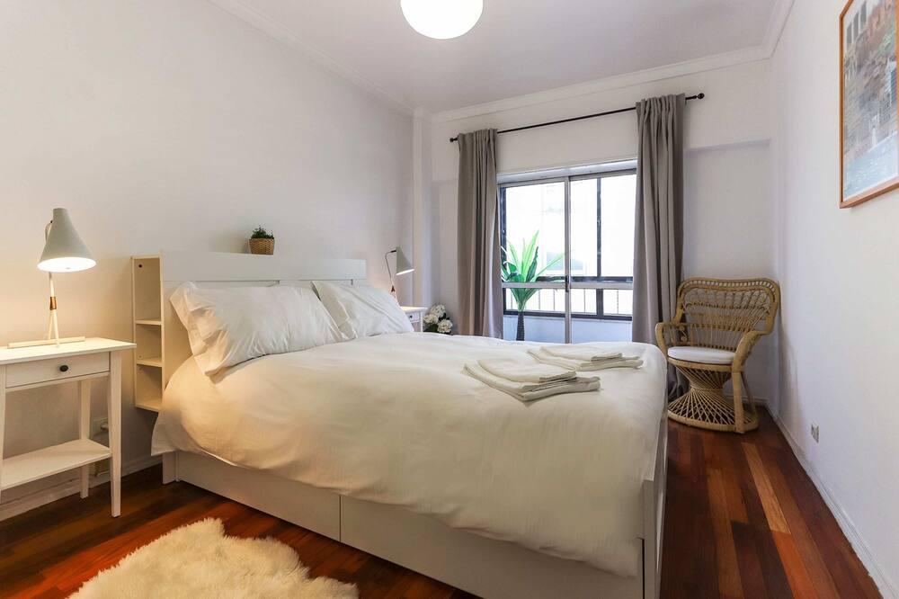 Apartamentai su pagrindiniais patogumais, Kelios lovos - Kambarys