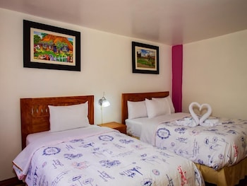 Foto van Hotel With Mountain Views With two Terraces - Triple Room 3 in Ollantaytambo