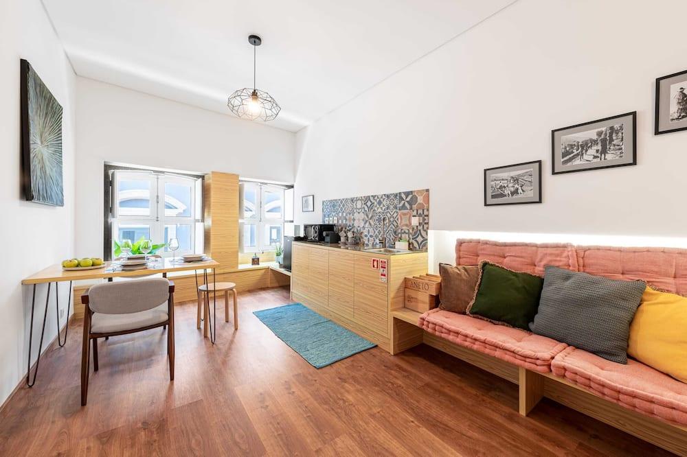 Studio typu Basic, dvojlůžko a rozkládací pohovka - Obývací pokoj