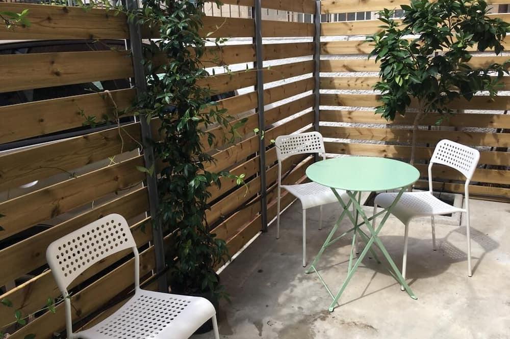 Апартаменти категорії «Комфорт» - Тераса/внутрішній дворик