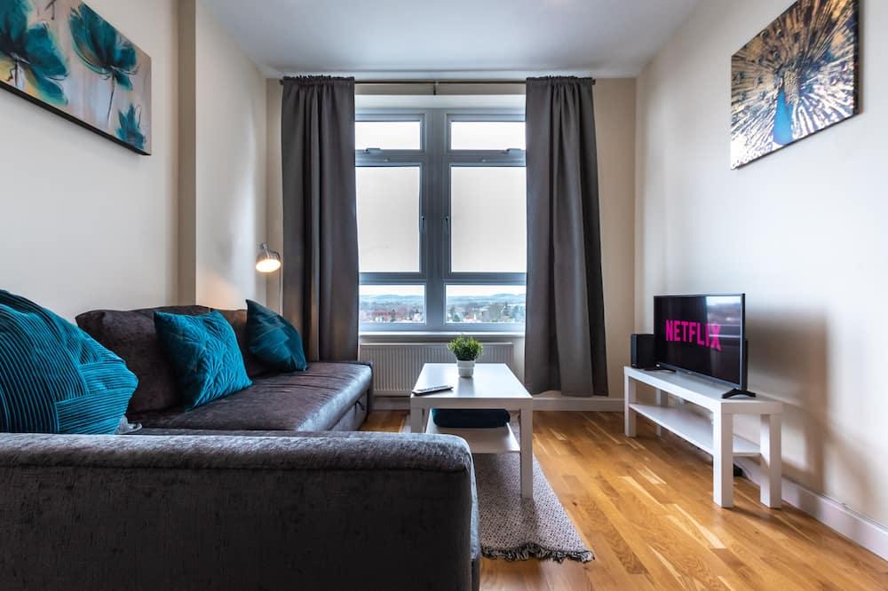 Apartmán, viacero postelí - Obývačka