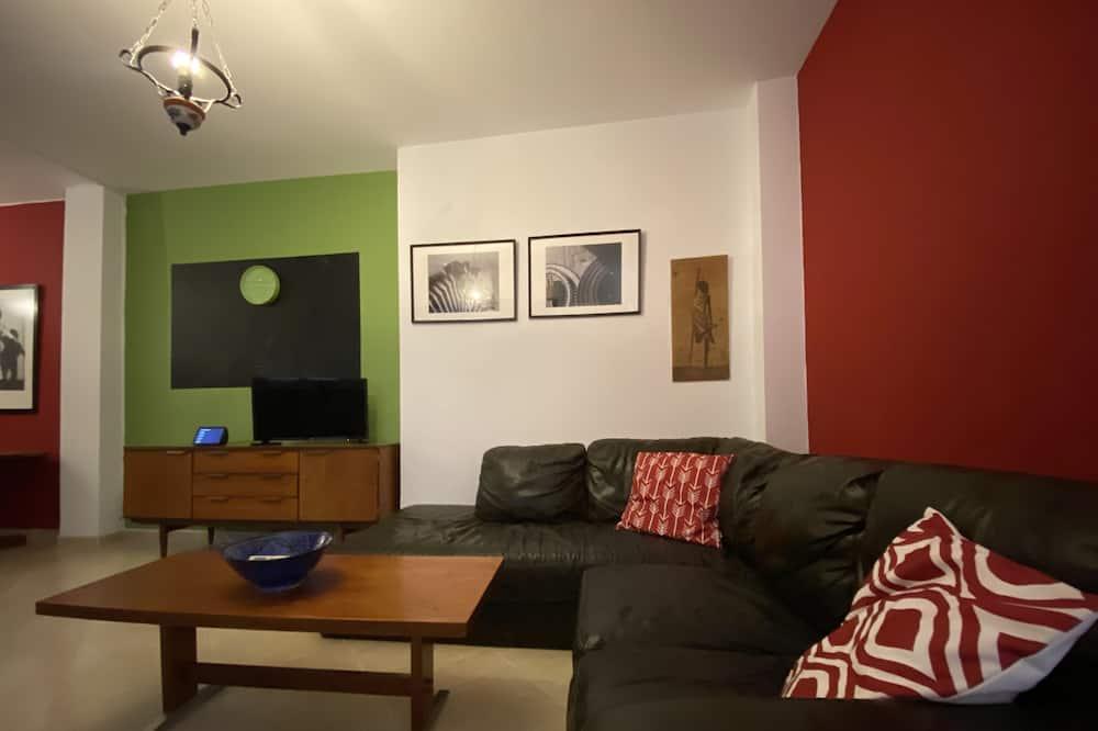Apartment, Mehrere Betten - Wohnzimmer