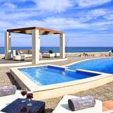 Beautiful three bedroom beachside villa, The Summer House, with air con and wifi