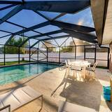 ☀ 1mi to Beach ☀ Heated Pool ☀ Custom Kitchen ☀