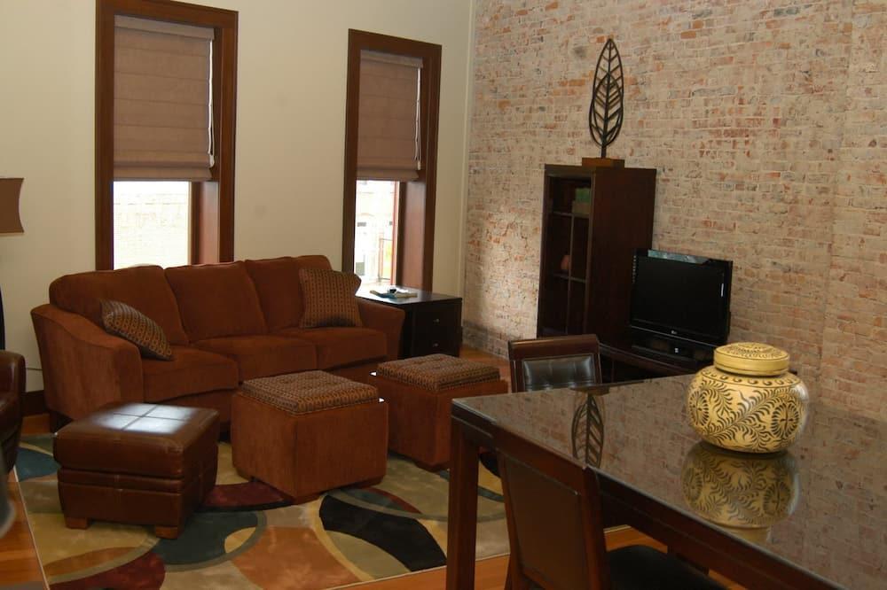 Deluxe-Suite, Kühlschrank und Mikrowelle - Wohnbereich