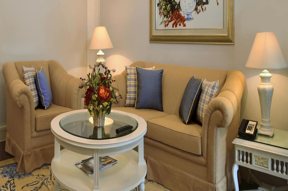 Suite, 1 Queen Bed, Multiple View (Savoy Suites) - Living Area