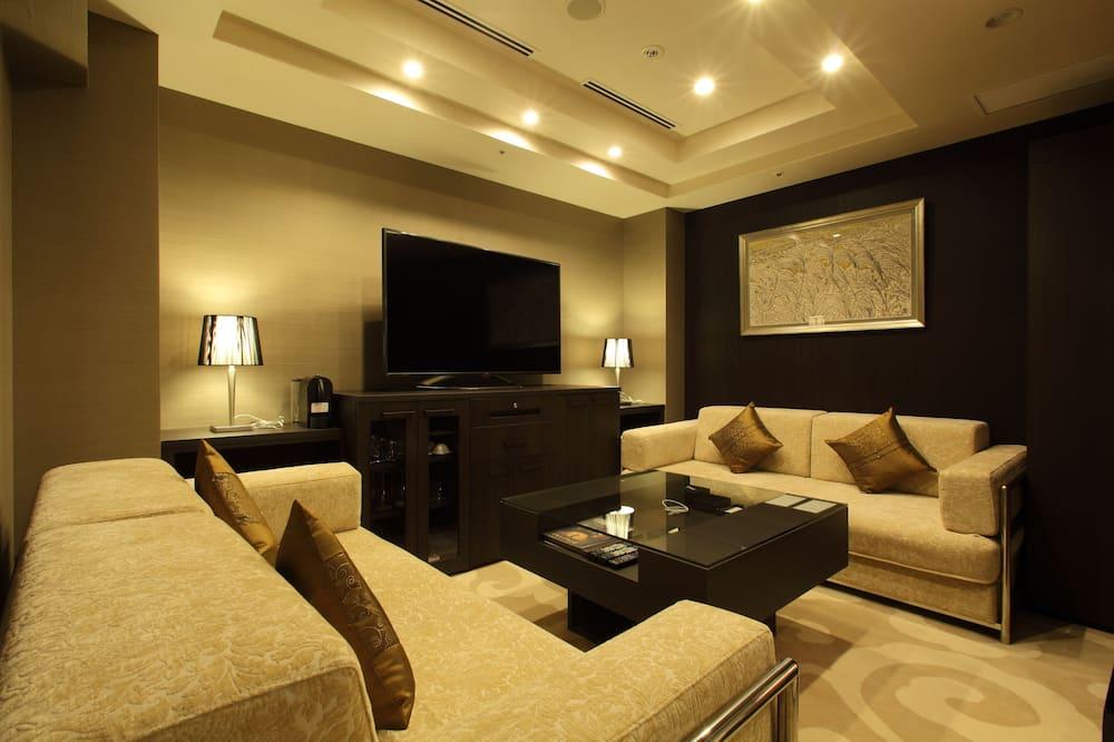 スイートルーム 禁煙 (クイーンベッド2台) -最上階-<大人5名様よりソファーベッドをご用意> - リビング エリア
