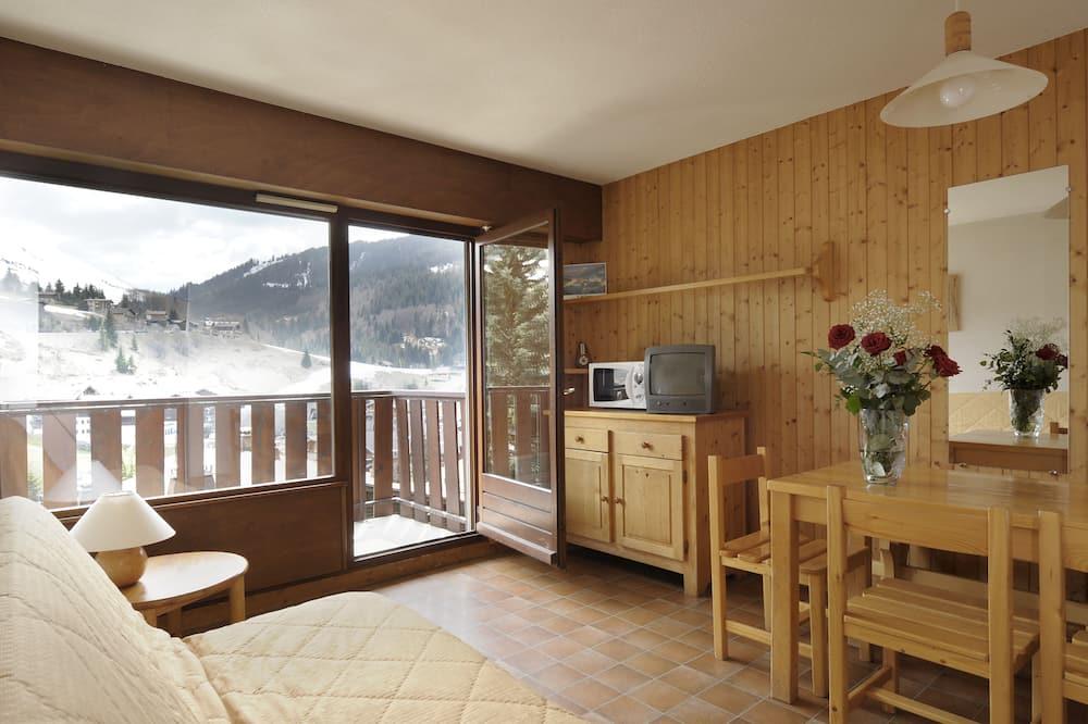 شقة - غرفة نوم واحدة (8) - غرفة معيشة
