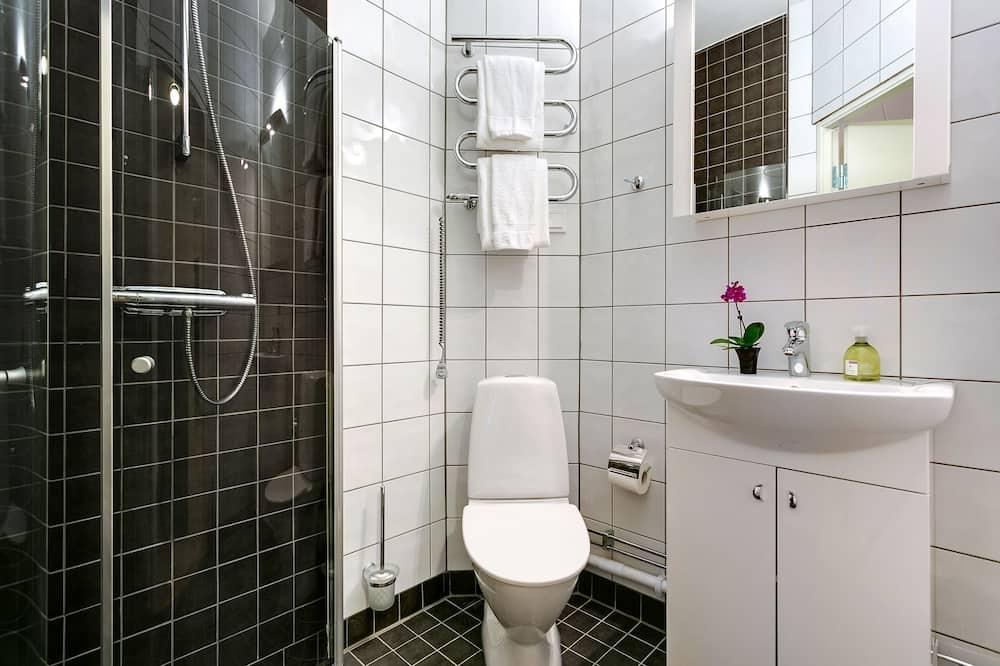 Studija, 2 viengulės lovos - Vonios kambarys