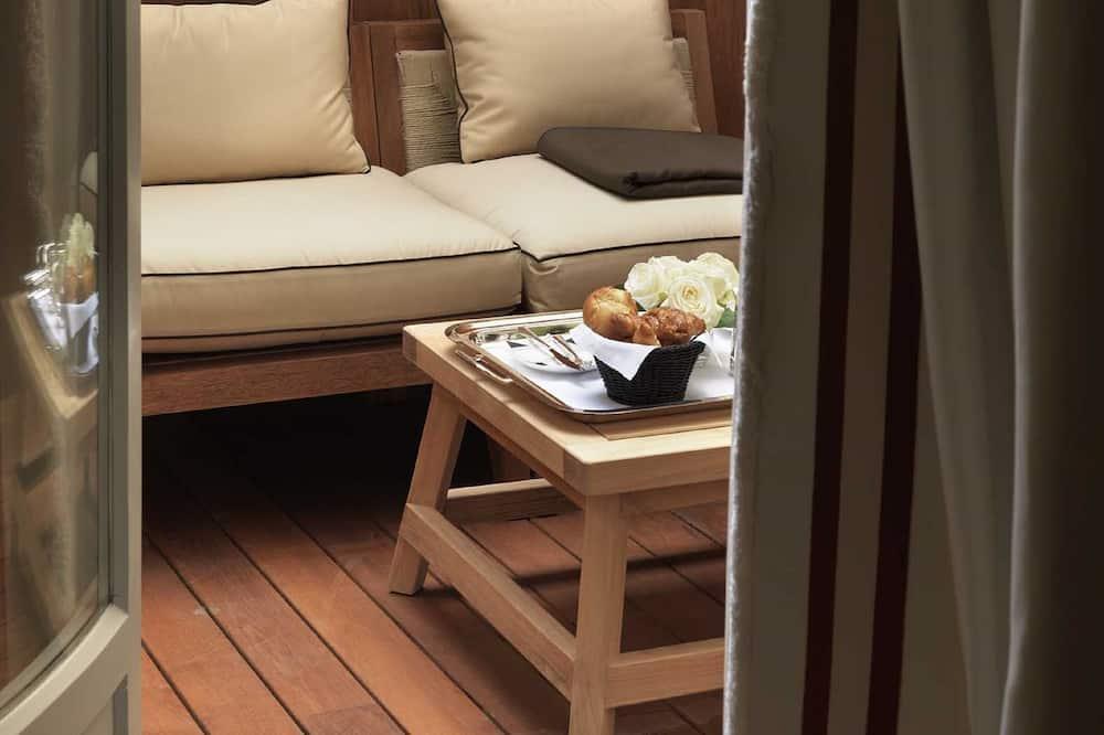 Suite, 1 cama King size con sofá cama - Habitación