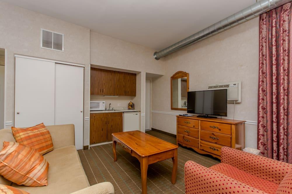 Suite, 1 cama king-size com sofá-cama - Área de Estar