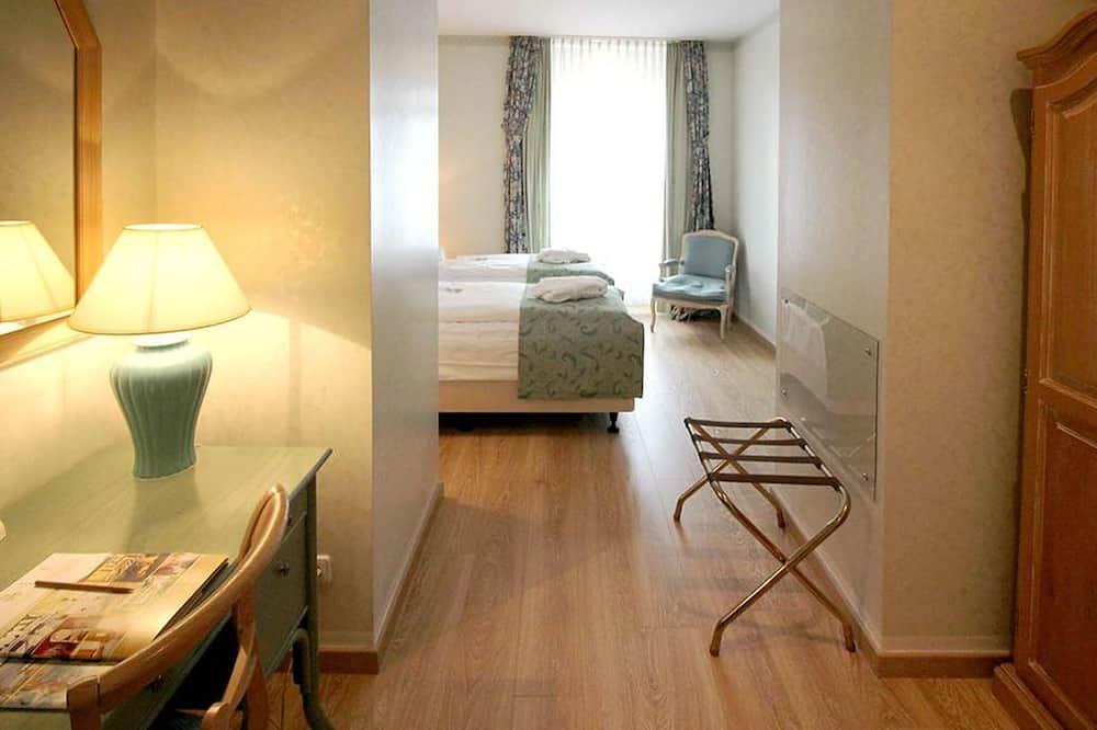 Стандартный двухместный номер с 2 односпальными кроватями - Зона гостиной
