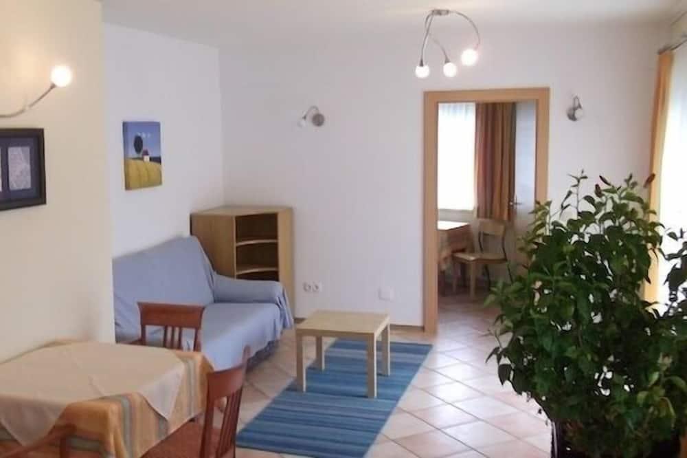 Familienapartment, 2Schlafzimmer, Terrasse, Gartenblick - Wohnbereich