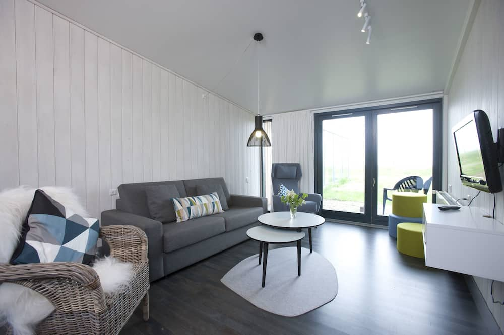 Family Apartment, Multiple Beds, Partial Sea View - Living Area