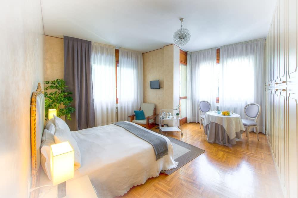 スーペリア ダブルまたはツインルーム 1 ベッドルーム - リビング エリア