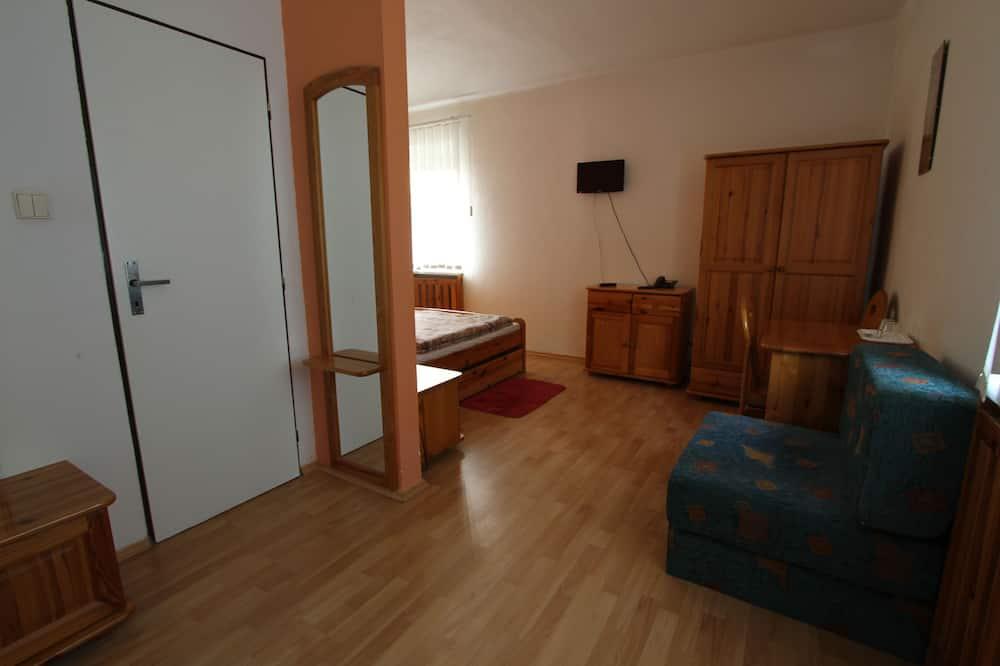 Chambre Triple - Coin séjour