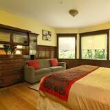 חדר דה-לוקס לארבעה, נוף לגן, אזור הגן - חדר אורחים