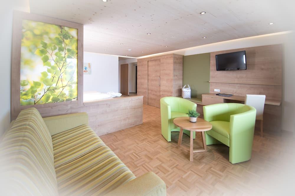 Pokoj typu Deluxe (C) - Obývací prostor