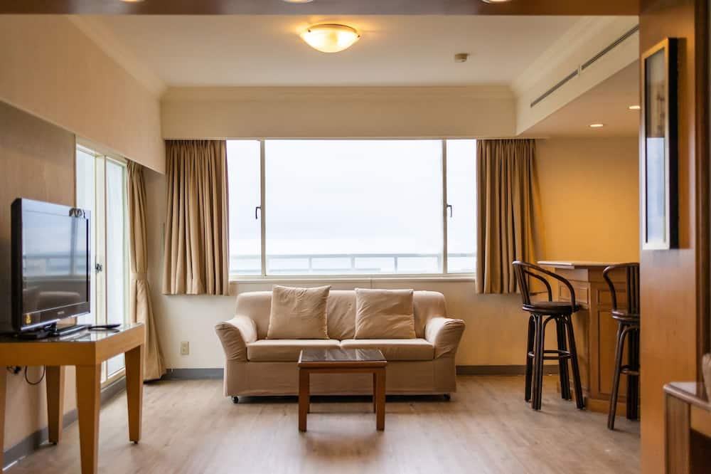 Habitación triple clásica, vista al mar - Sala de estar