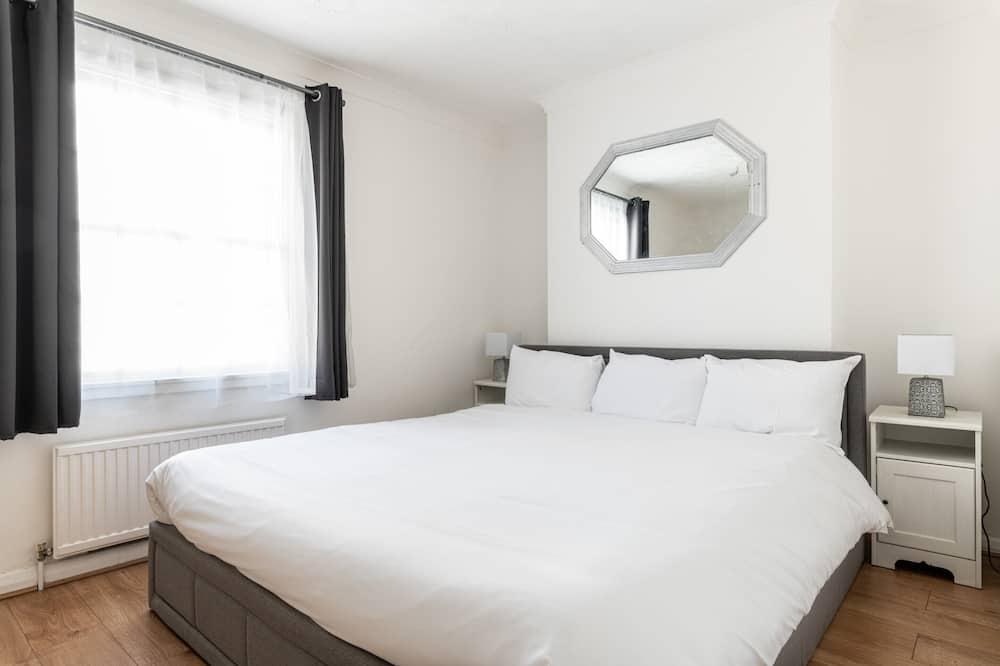 Eenvoudige resortwoning, Meerdere bedden - Kamer