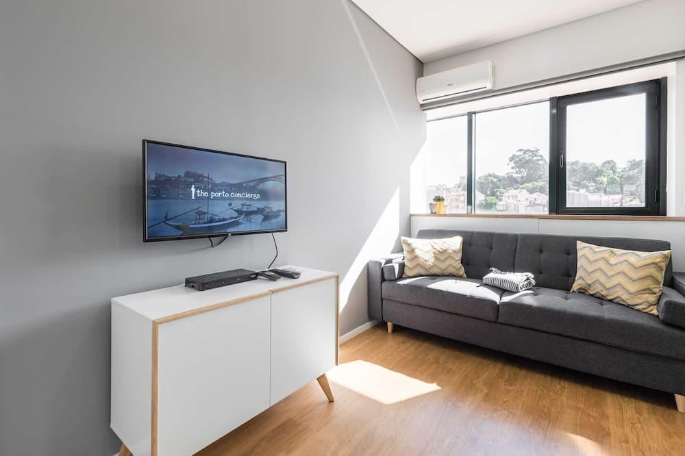 Апартаменты базового типа, Несколько кроватей - Гостиная