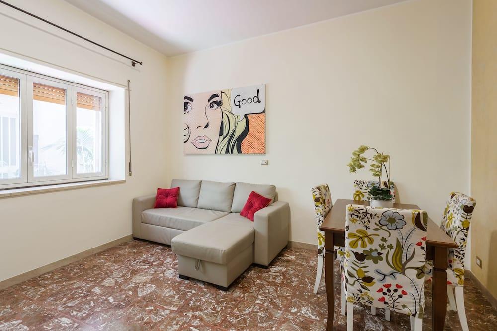 Семейные апартаменты, 1 спальня, патио - Зона гостиной