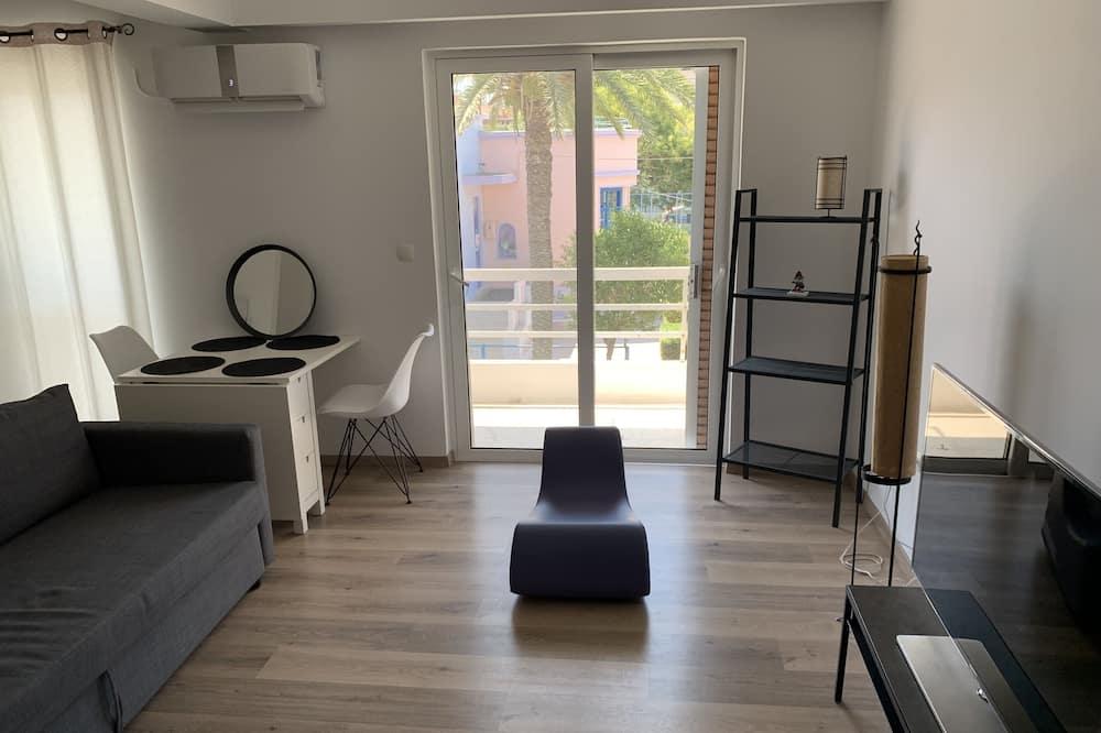 City Apartment - Ruang Tamu