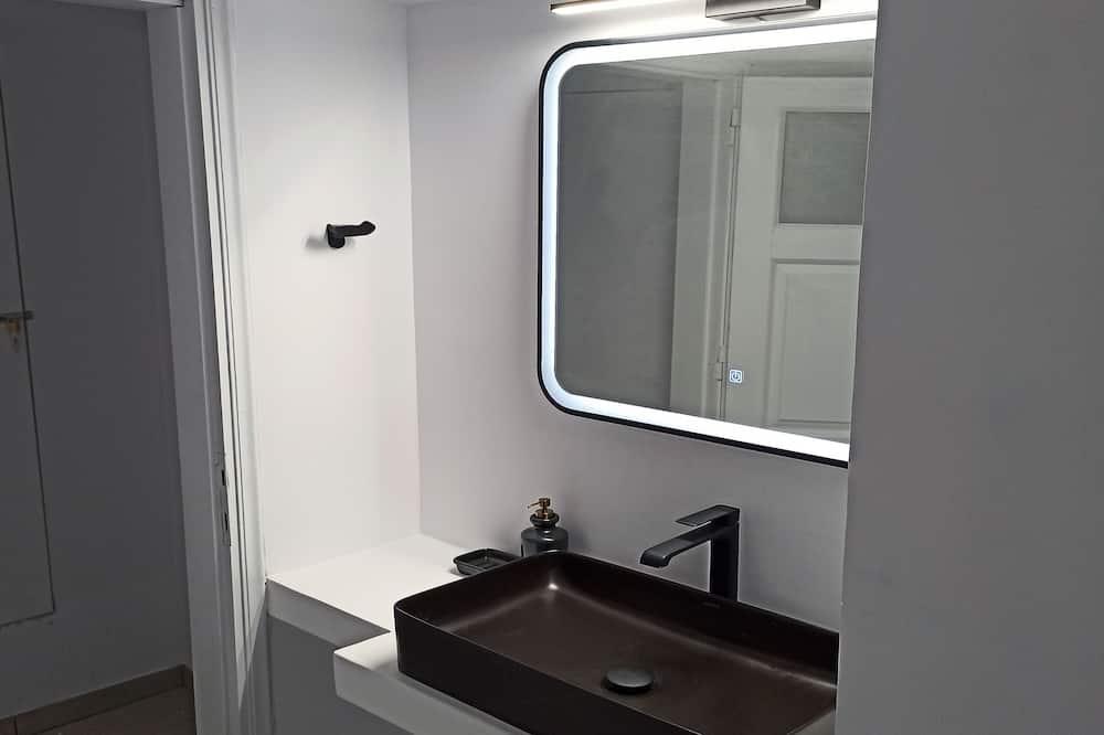 Deluxe appartement, Uitzicht op zee - Badkamer