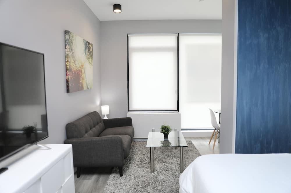 Štúdiový apartmán typu Deluxe, 1 extra veľké dvojlôžko, balkón - Obývacie priestory