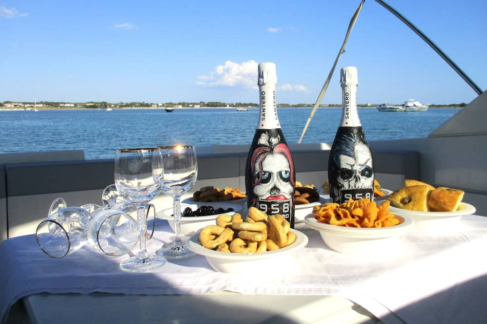 Aperitif In Luxury Yacht At Sunset