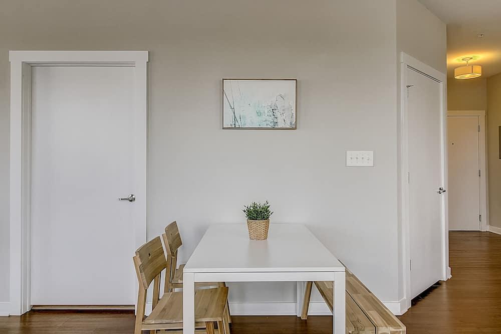 Appartement, keuken, Uitzicht op de stad (1 Bedroom) - Eetruimte in kamer