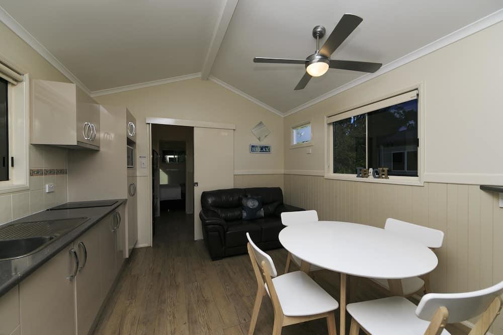Standaard huisje - Eetruimte in kamer